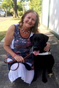 Maribel with black lab dog guide