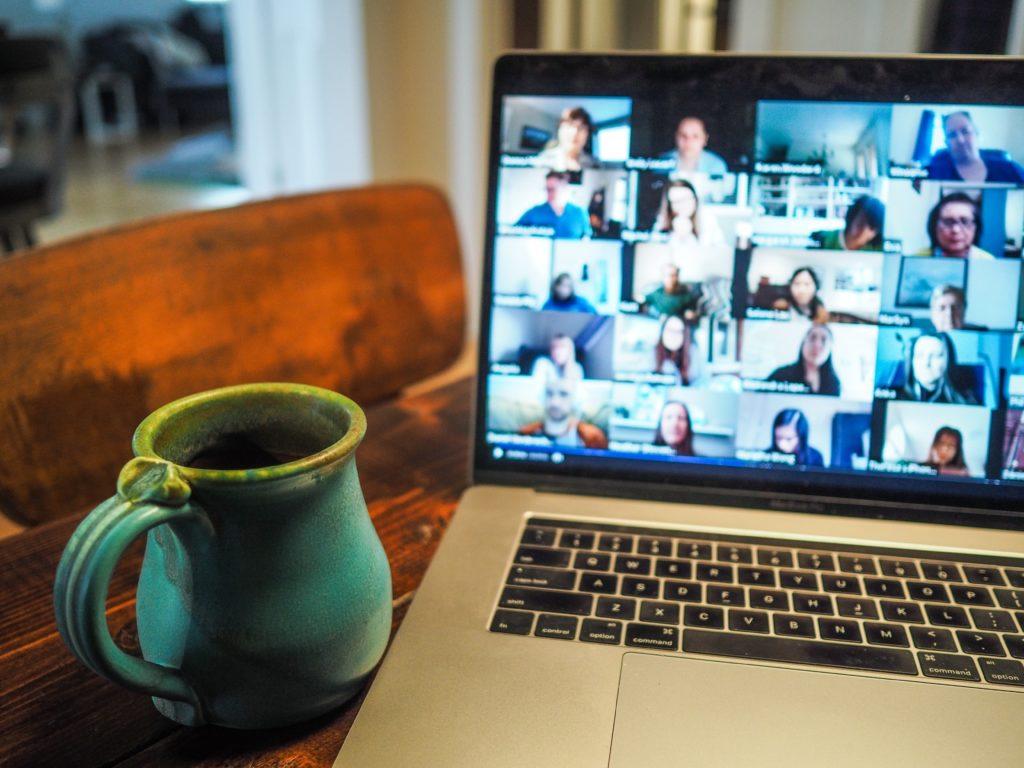 laptop showing participants on a webinar