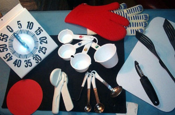 accessible cooking utensils including kitchen timer, measuring cups and spoons, etc.