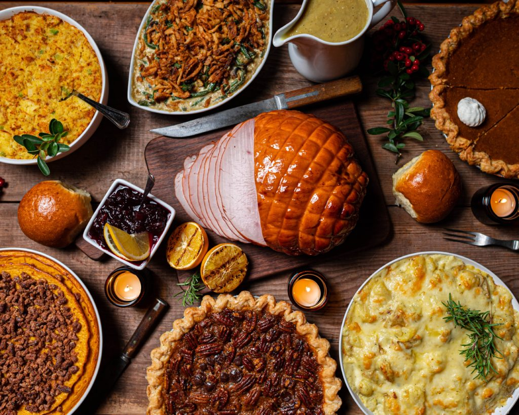 Thanksgiving meal in serving dishes on a table.