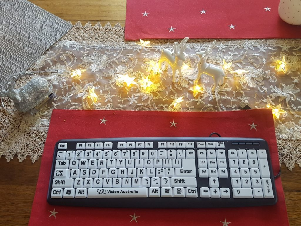 high definition keyboard which has white keys and large black letters