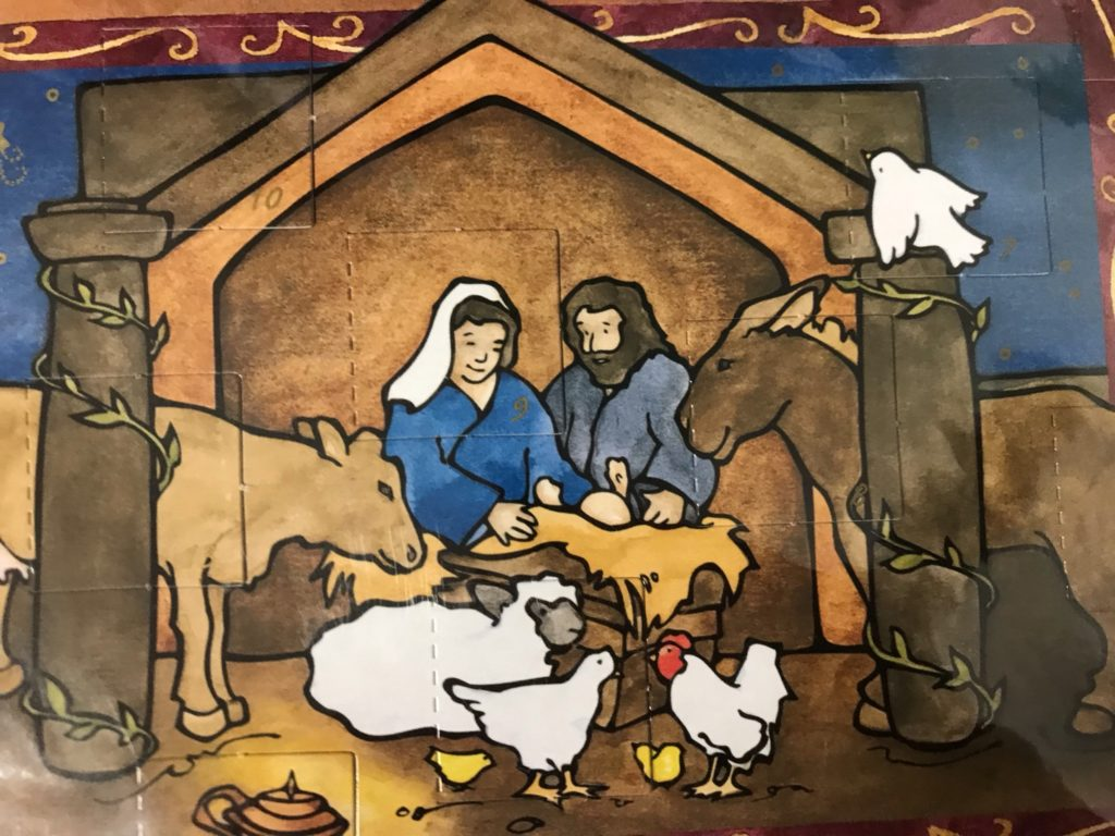 manger scene with cradle, chickens, cows, sheep, horses, Mary and Joseph