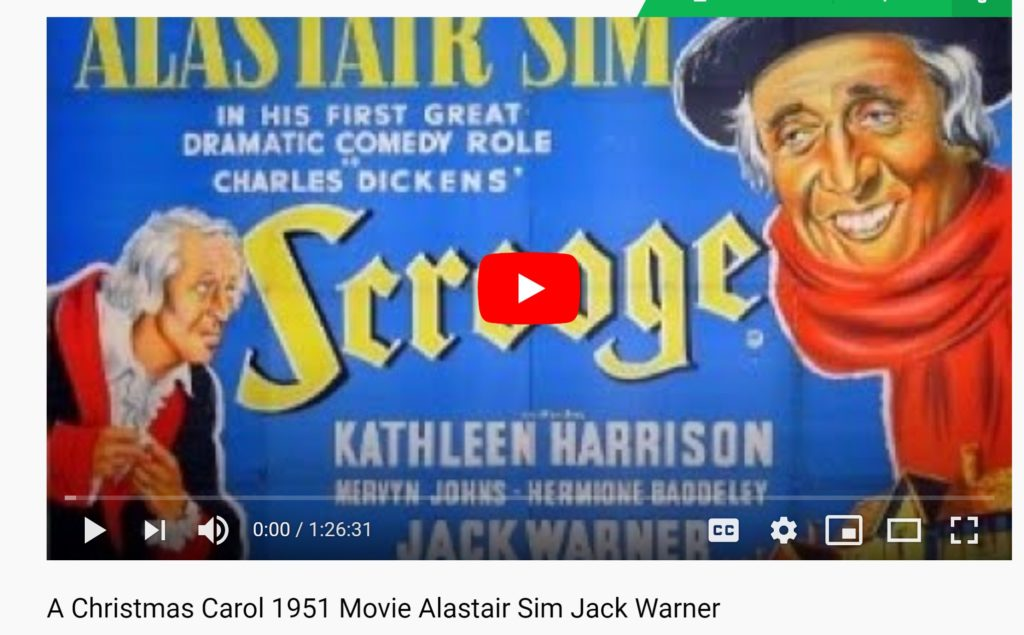 "Screenshot image of 1951 film ""A Christmas Carol,"" produced by Jack Warner, opening shot. Image shows Alastair Sims dressed as Scrooge. The image states: Alastair Sim, in his first great dramatic comedy role in Charles Dickens' Scrooge."" Other actors Kathleen Harrison, Mervin Jones, Hermoine Baddley.   https://www.youtube.com/watch?v=EaY5pQ__cdI&feature=youtu.be"