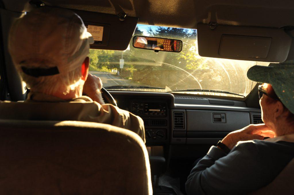 older couple driving in car. attribute: https://unsplash.com/@wonderlane