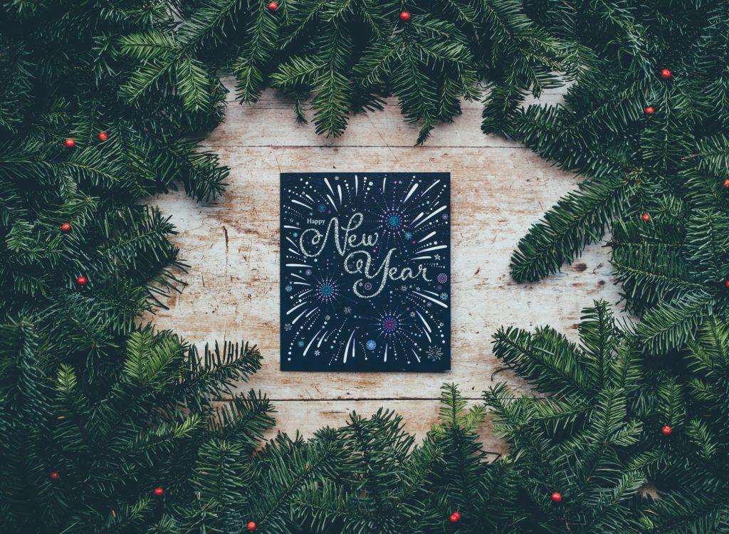 new years wording inside wreath. photo by Annie Spratt Unsplash