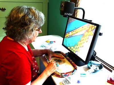 Lynda working in her studio using video magnifier