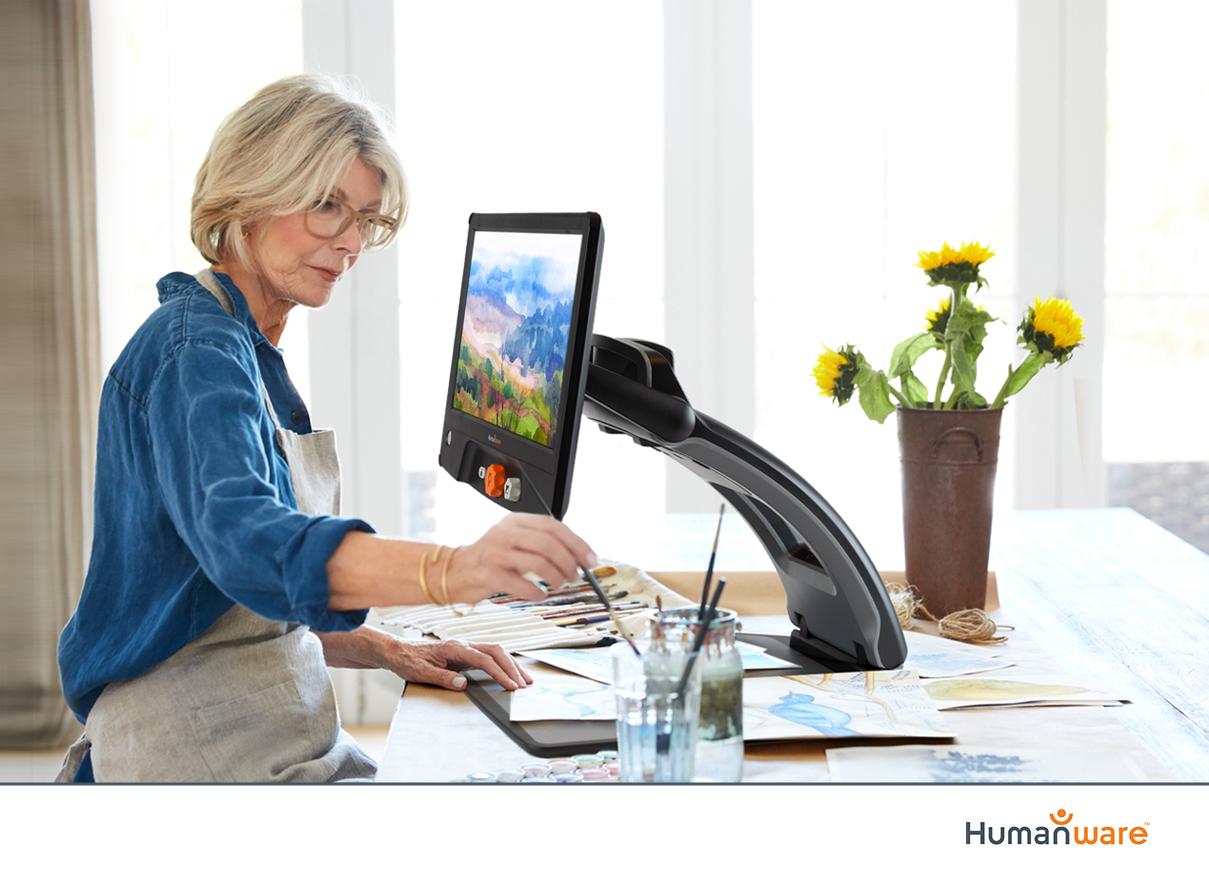 woman using desktop electronic magnifier