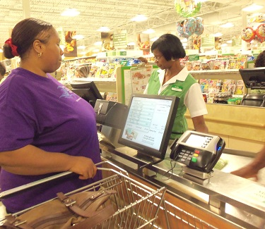 blind woman at cash register at grocery store checking out