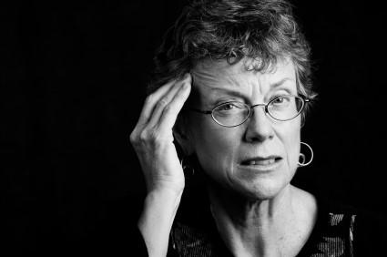 older woman wearing glasses looking upset