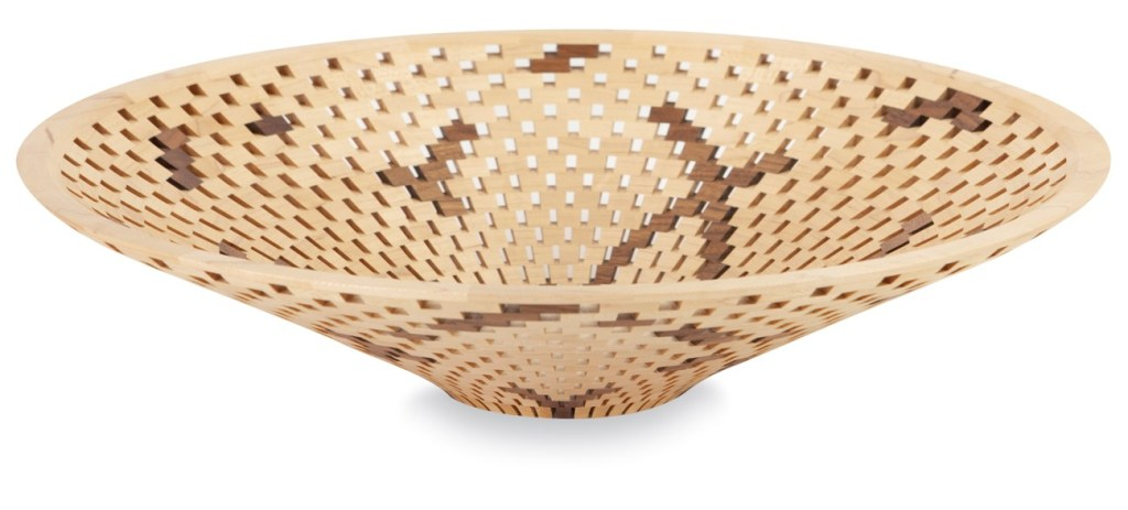 round, wooden latticed bowl with light and dark wood
