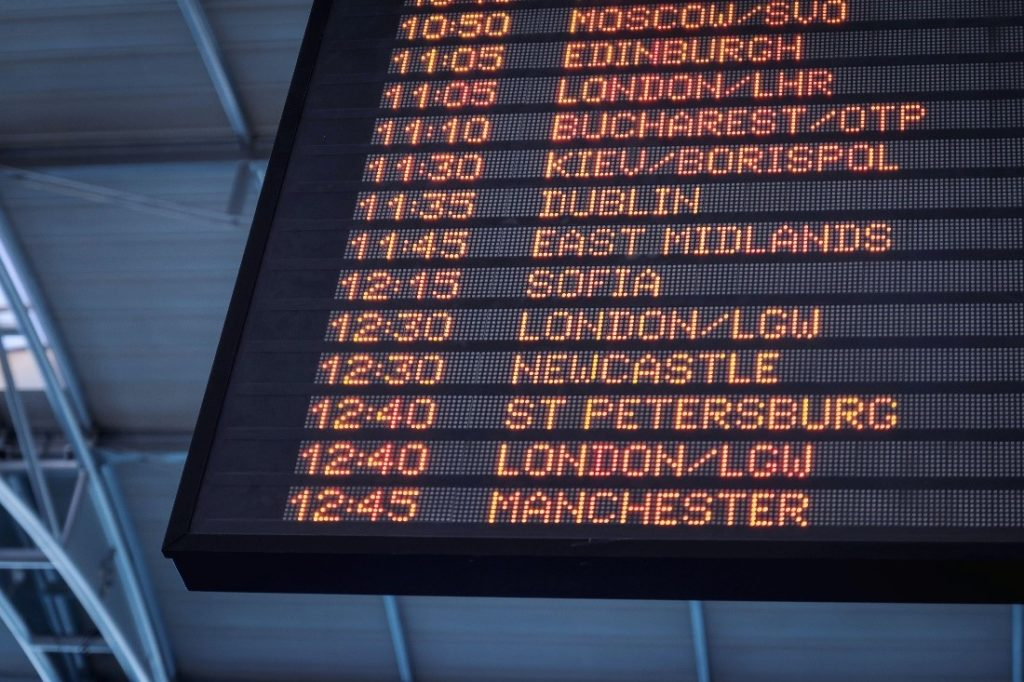airport flight schedule showing flight times and listing of international cities