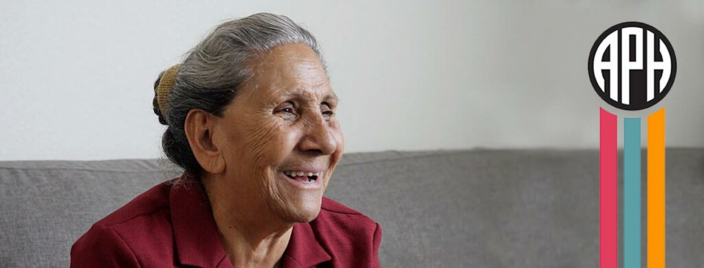 Photo of woman sitting on couch smiling